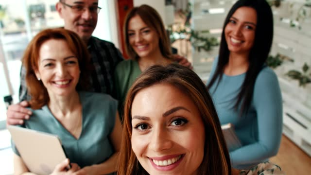 The best team Smiling business team taking selfie at the office. partnership teamwork stock videos & royalty-free footage