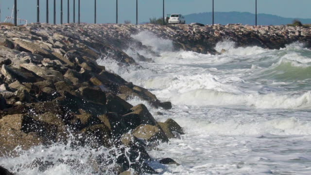 The big waves splashing on the big rocks in the sea The big waves splashing on the big rocks in the sea on the baywalk area in the city indian ocean islands stock videos & royalty-free footage