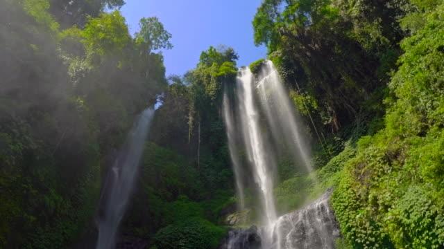 the biggest waterfall on the Bali island-the Sekumpul waterfall. Slowmotion shot. Travel to Bali concept