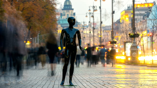 the black dummy standing in a people crowd in the street. time lapse - один объект стоковые видео и кадры b-roll