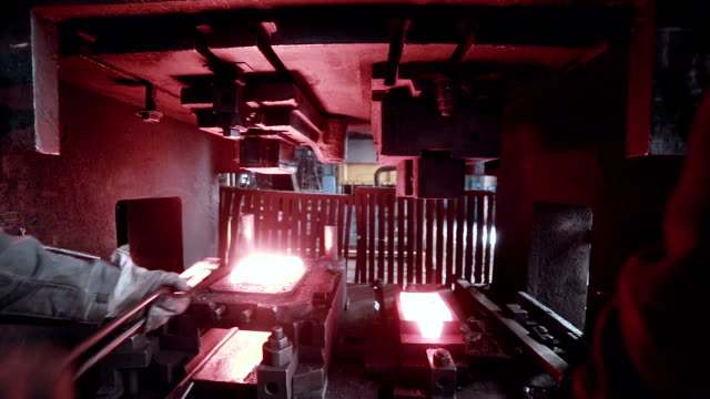 The blacksmith works at the forge industrial press The blacksmith works at the forge press. HD. blacksmith shop stock videos & royalty-free footage