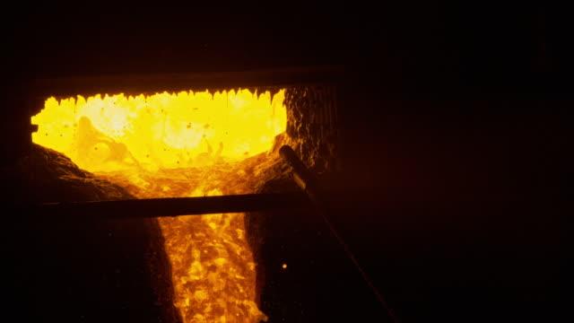 The blast furnace liquid metal The blast furnace liquid metal, shop metallurgical plant foundry stock videos & royalty-free footage