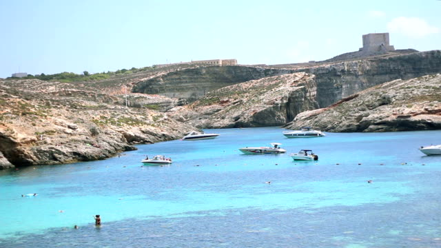 The Blue Lagoon bay and castle on top of a cliff in Comino island. Malta video