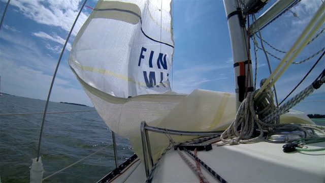 The boat raises the sail and out to sea. video