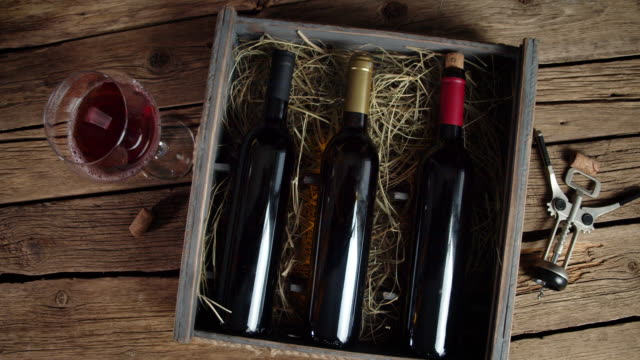 The box with wine bottles is slowly rotating.