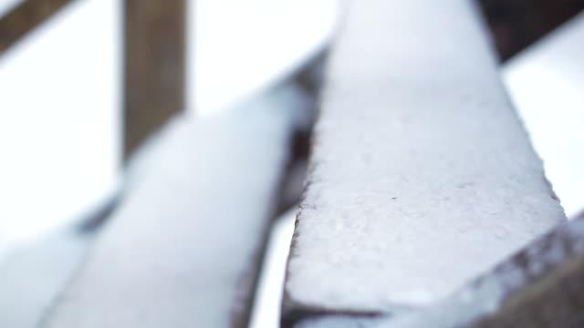 vídeos y material grabado en eventos de stock de el niño sube las escaleras cubiertas de nieve de madera. - basement