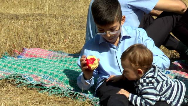 The boy eats an apple