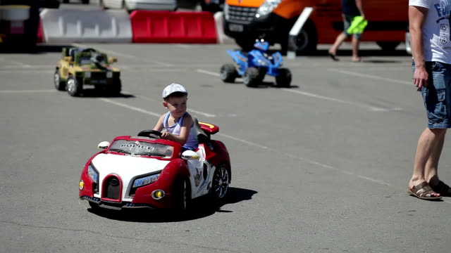 The boy goes to the kid's car The boy ride on the kid's car go cart stock videos & royalty-free footage