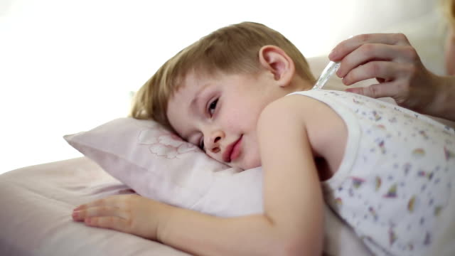 The boy is sick and he has fever video