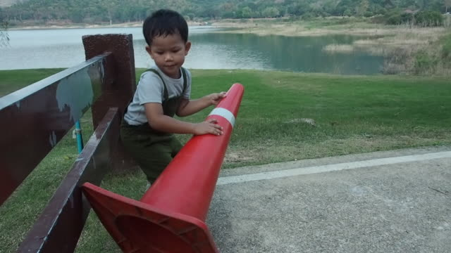 The boy lays the Traffic Cone.