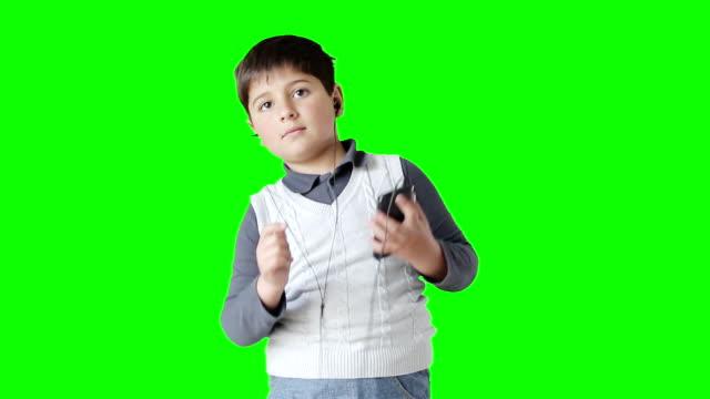 the boy listens to music and dances - neonati maschi video stock e b–roll