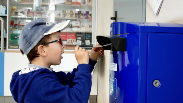 The boy puts his first letter in the mail box video