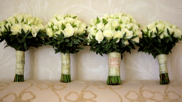The brides bouquet and the bridesmaids video