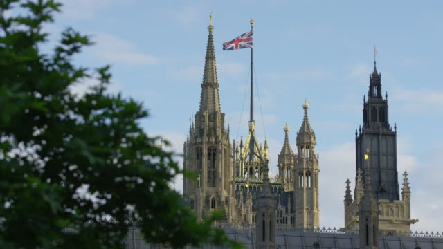 The British flag waving on the Westminster Palace