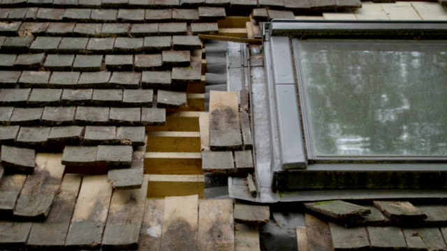 The broken roof shingles of an old house video