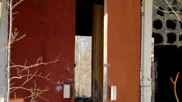 The brown door of the ruined property from the war video