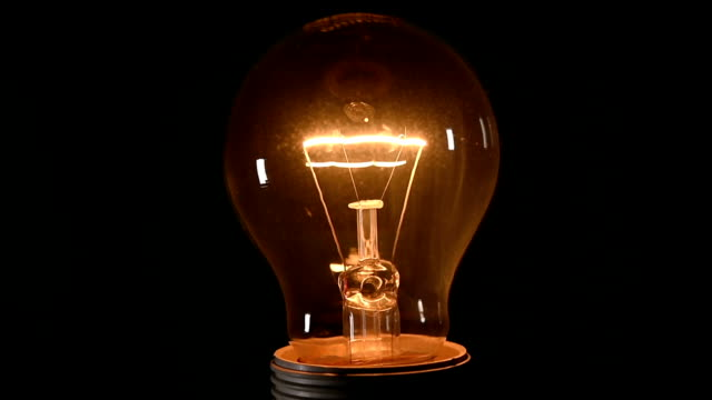 the bulb on black background video