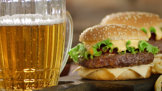 The burger and beer are rotating slowly.