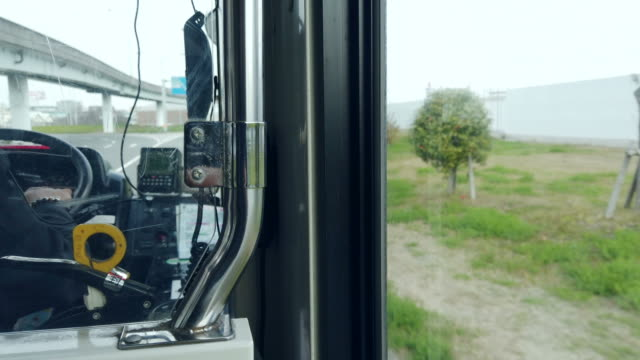 the bus driver is driving along the road. - bus driver stock videos and b-roll footage