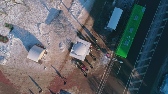 The bus stop from above The aerial drone view directly above on the bus stop. Minsk, Belarus, Eastern Europe. bus stop stock videos & royalty-free footage