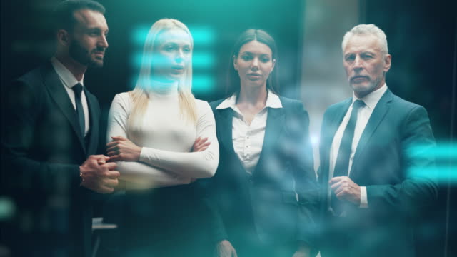vídeos de stock e filmes b-roll de the business people working on a virtual holographic screen - business woman hologram