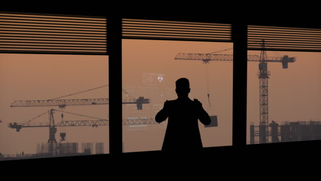 the businessman works with holographic data on a virtual display - man look sky scraper video stock e b–roll