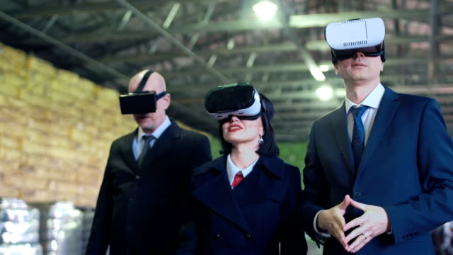 The businesspeople in VR headset in storage video