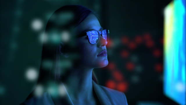 The businesswoman standing near the screen
