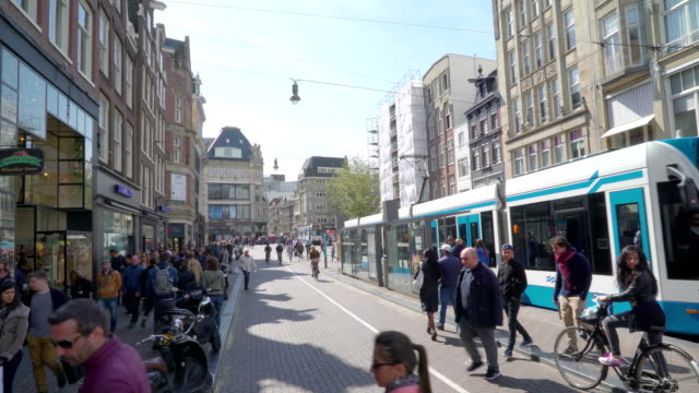 The busy people on the streets in Amsterdam video