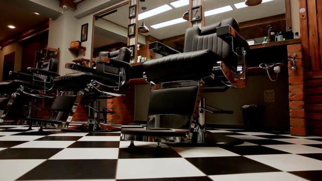 the camera on the Steadicam shows the interior of a Barber shop with a beautiful design video