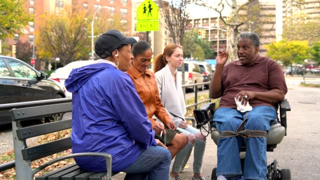 The candid video of the Black family with the White teenager girl hanging in the square in Bronx video