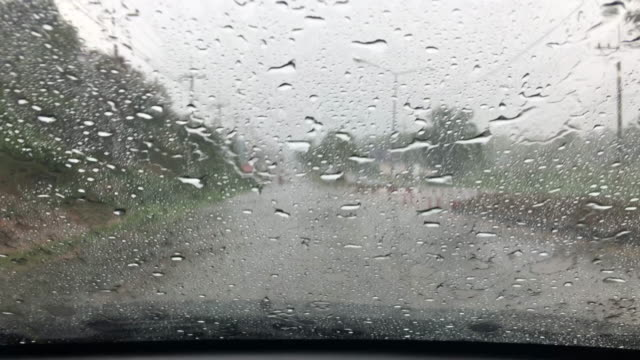 The car driver ran into the tunnel while it was raining.