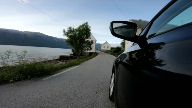 The car is driving on the Sognefjord - video