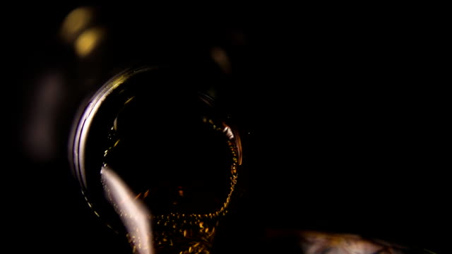 The carbonated drink pours into the glass. Slow mo video