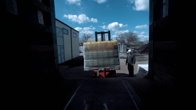 The cargo loading The cargo is being loaded to the truck with the vehicle. forklift stock videos & royalty-free footage