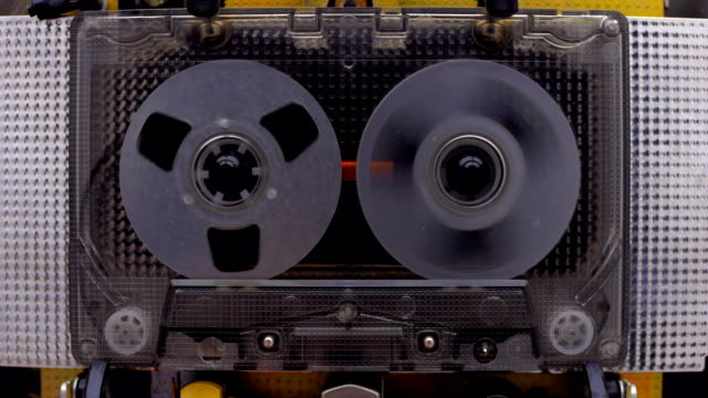 The cassette is played in the tape recorder and rewind the reel of the tape video