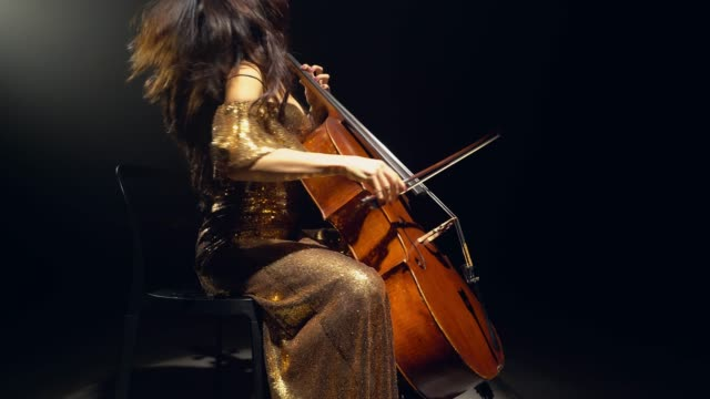 the cellist performs on stage. - orchestra video stock e b–roll