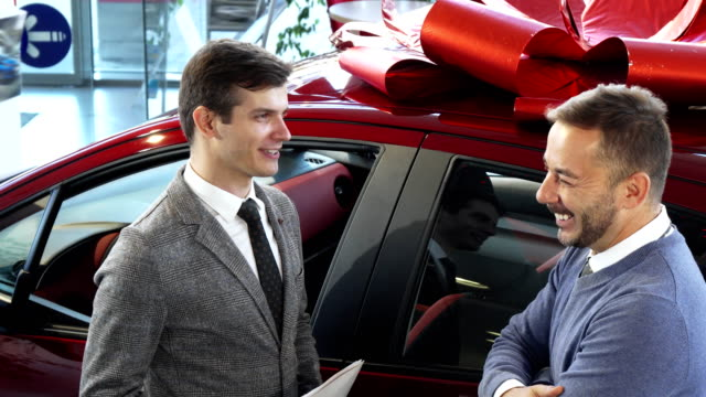 The cheerful buyer and the seller to discuss details of the contract video