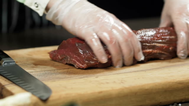 The chef cuts meat into steaks. video