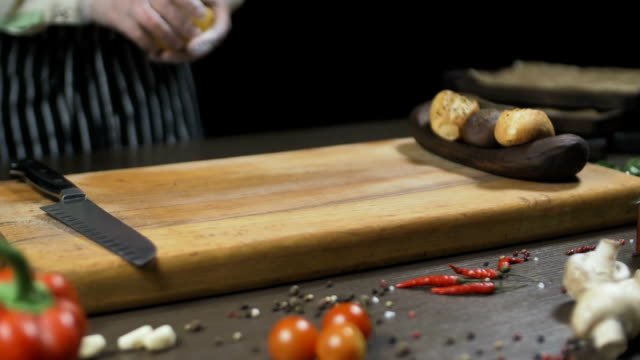 The chef Cuts the lemon on a wooden board. video