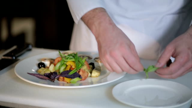 the chef decorates the salad the chef decorates the salad leaves garnish stock videos & royalty-free footage