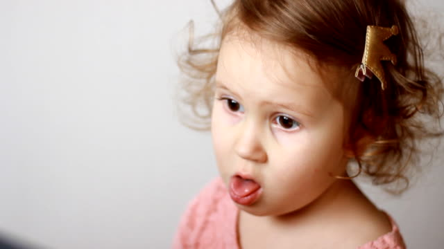 The child coughs. Portrait of a cute little girl close-up. The concept of cough, colds, viruses The child coughs. Portrait of a cute little girl close-up. The concept of cough, colds, viruses coughing stock videos & royalty-free footage