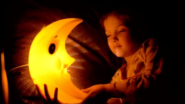 The child falls asleep under a lamp. video