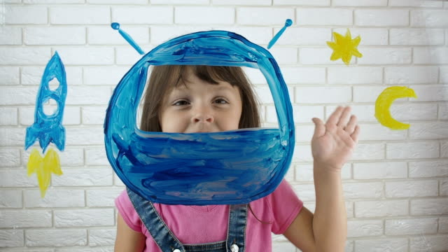 the child is an astronaut. - onirico video stock e b–roll