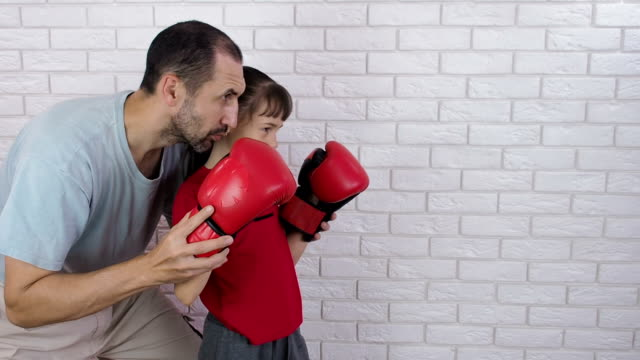 The child is engaged in boxing. video
