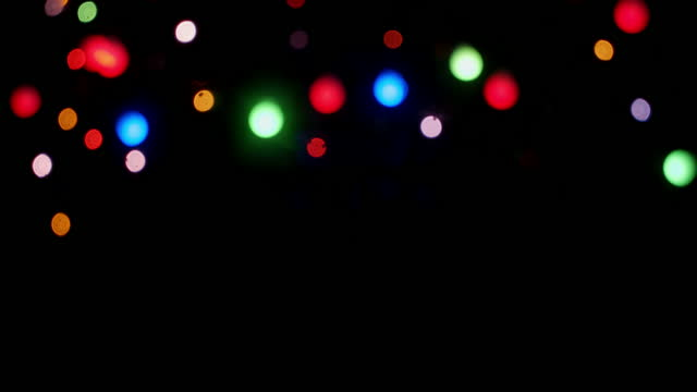 The Christmas lights of the garland sparkle brightly.