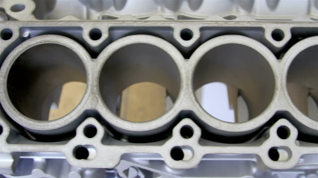 The circles on the engine blocks inside the car video