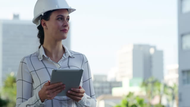 The city is like canvas to a civil engineer 4k video footage of a young businesswoman wearing a hardhat and using a digital tablet against an urban background civil engineering stock videos & royalty-free footage