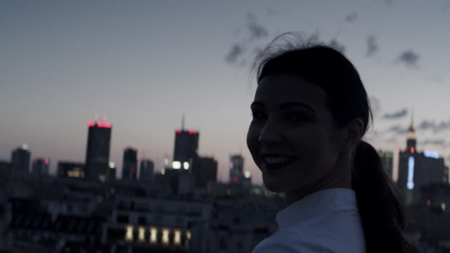 The city is mine. Businesswoman relaxing on a rooftop