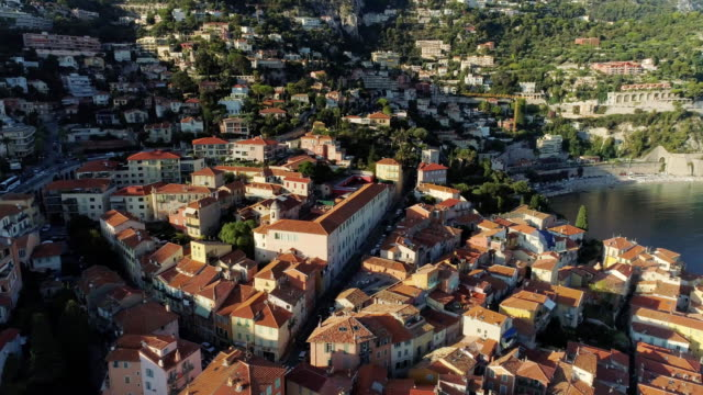 The city of Nice in the south of France on the azure coast is a view from above on the roofs of houses and roads Nice city Yachts in the sea Roads in the mountains drone flight building, city, coast, europe, france, house, landscape provence alpes cote d'azur stock videos & royalty-free footage